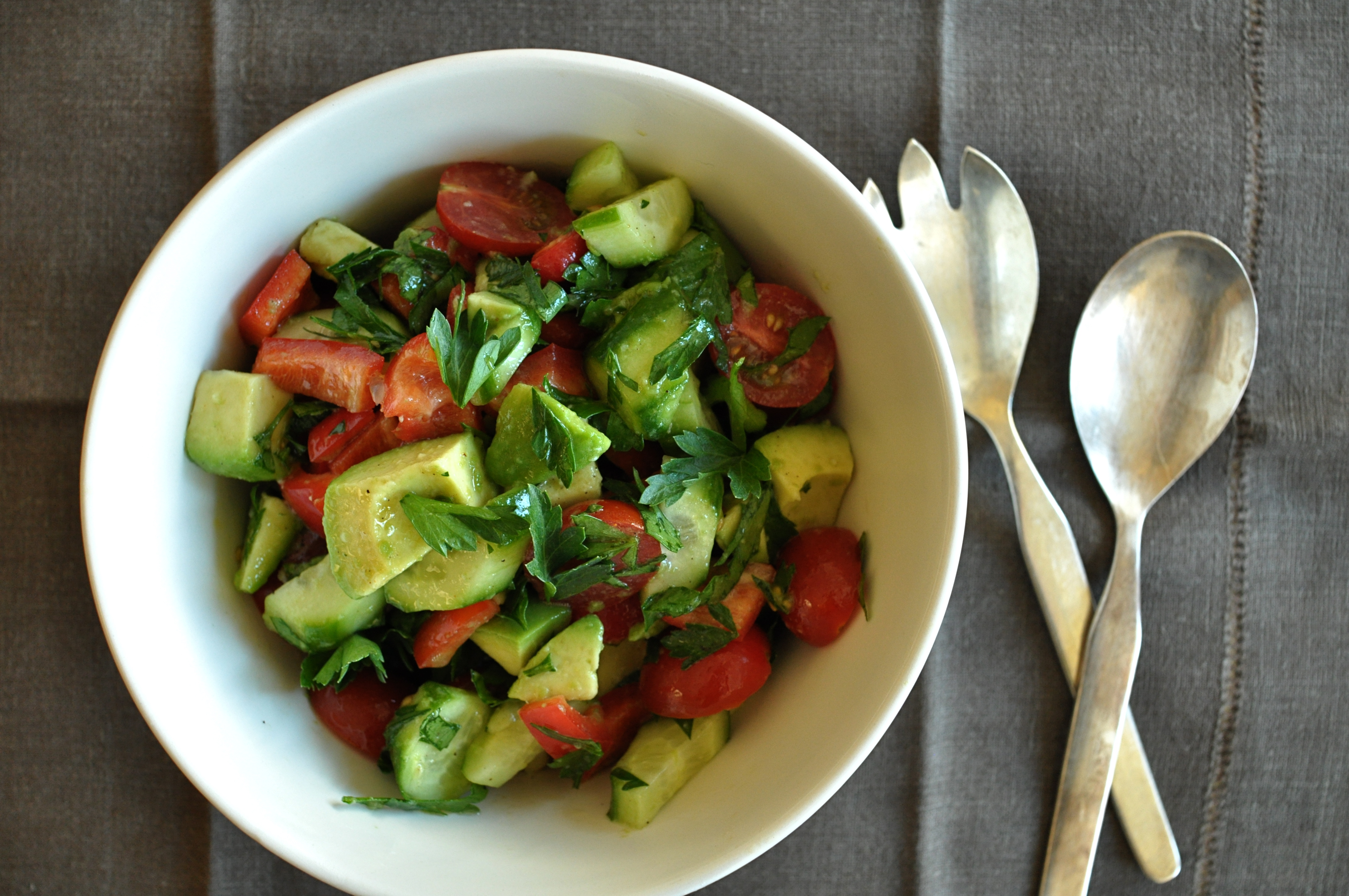 Avocado, cherry tomato, and cucumber salad with red pepper and parsley ...